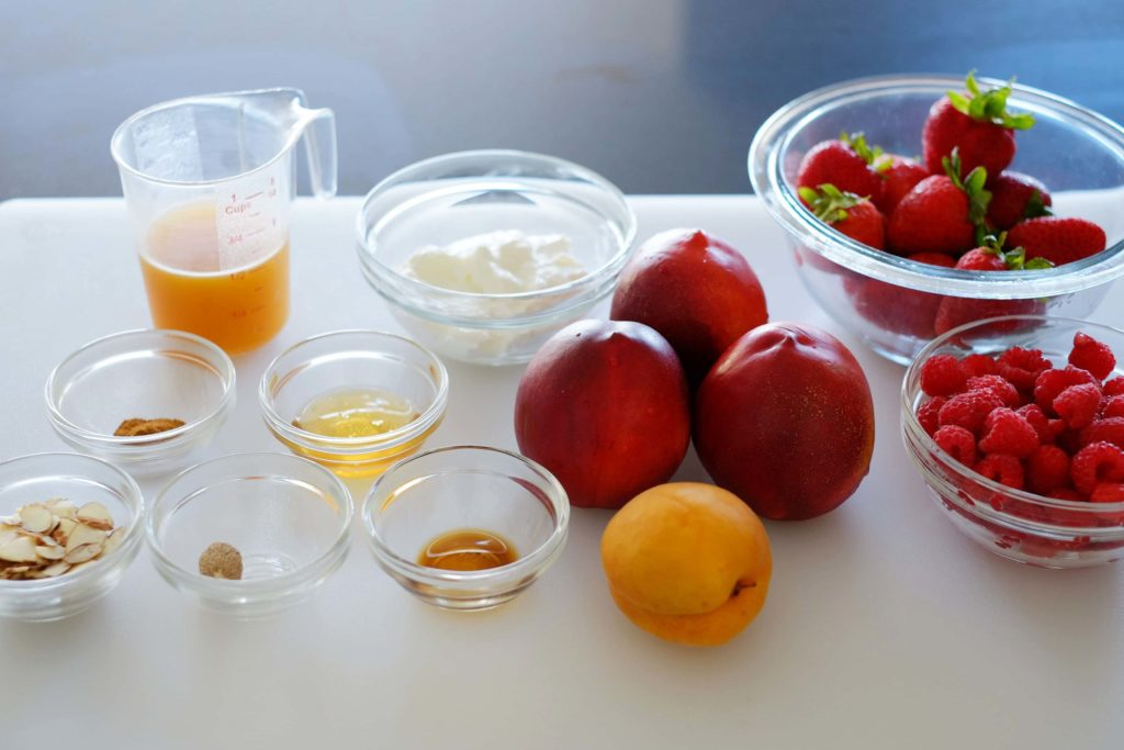 ingredients for summer fruit cups with apricot nectar sauce on cutting board