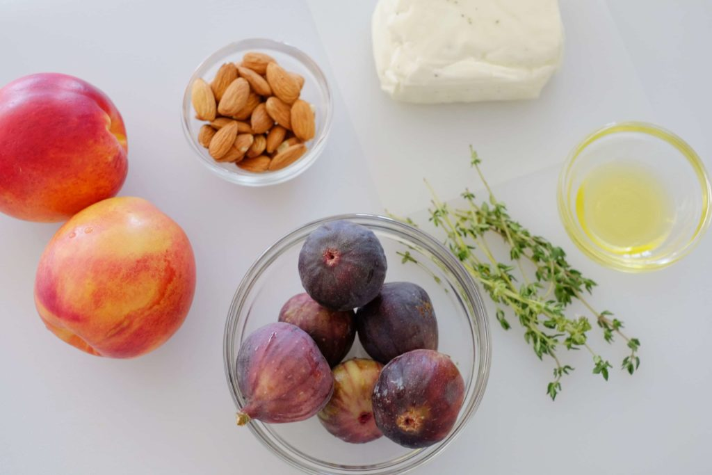 raw ingredients - fresh figs, nectarines, almonds, thyme, olive oil, halloumi cheese