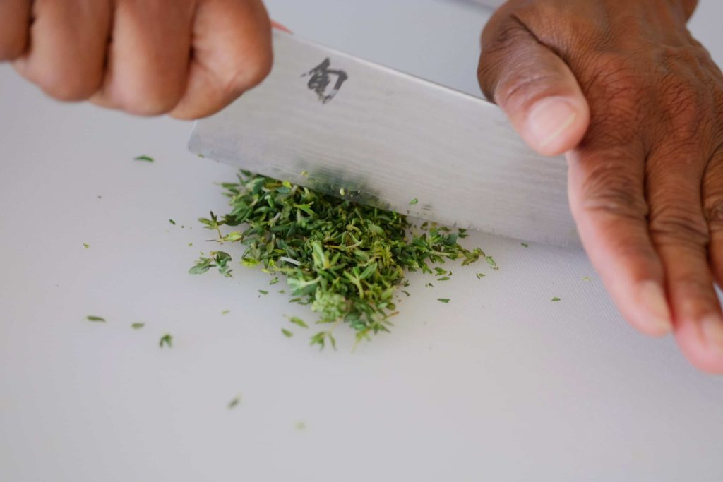 finely chopping fresh thyme