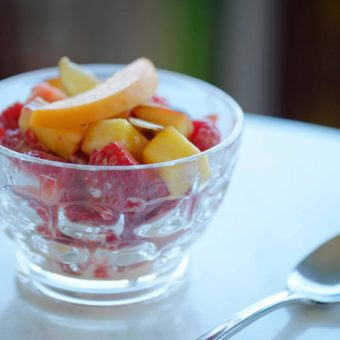 apricots nectarines strawberries and raspberries in a class cup