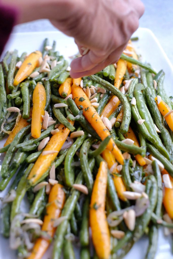 Roasted green bean and carrots sprinkled with almond slivers