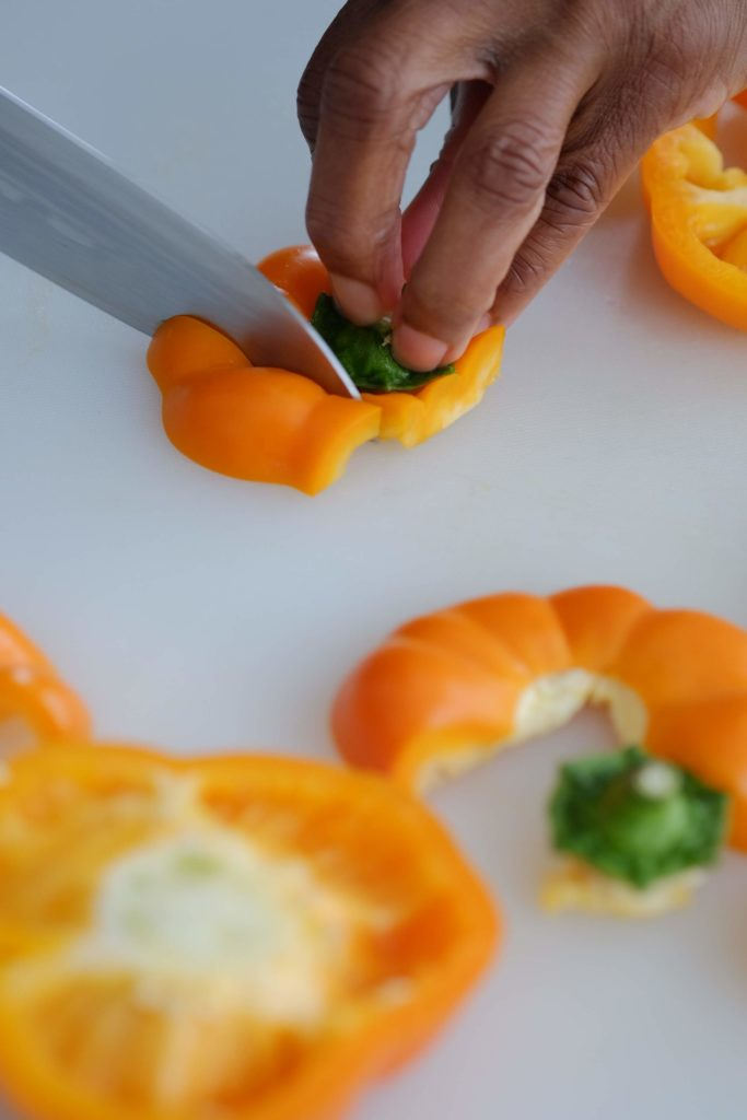 Yellow bell pepper stem being removed