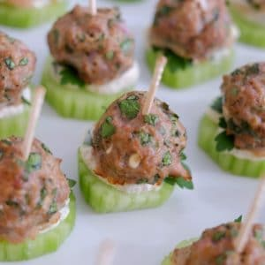 Lamb meatballs with yogurt tahini sauce and cucumber on a plate