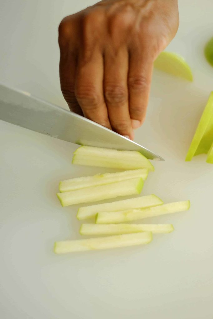 Slicing apple matchsticks with a knife