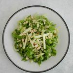 Arugula apple and fennel salad on plate