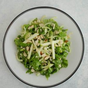 Arugula apple and fennel salad on plate