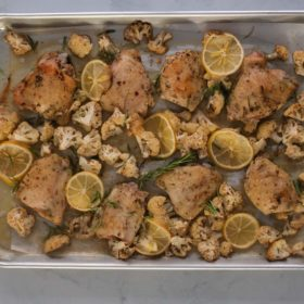 roasted lemon rosemary chicken and cauliflower on a sheet pan