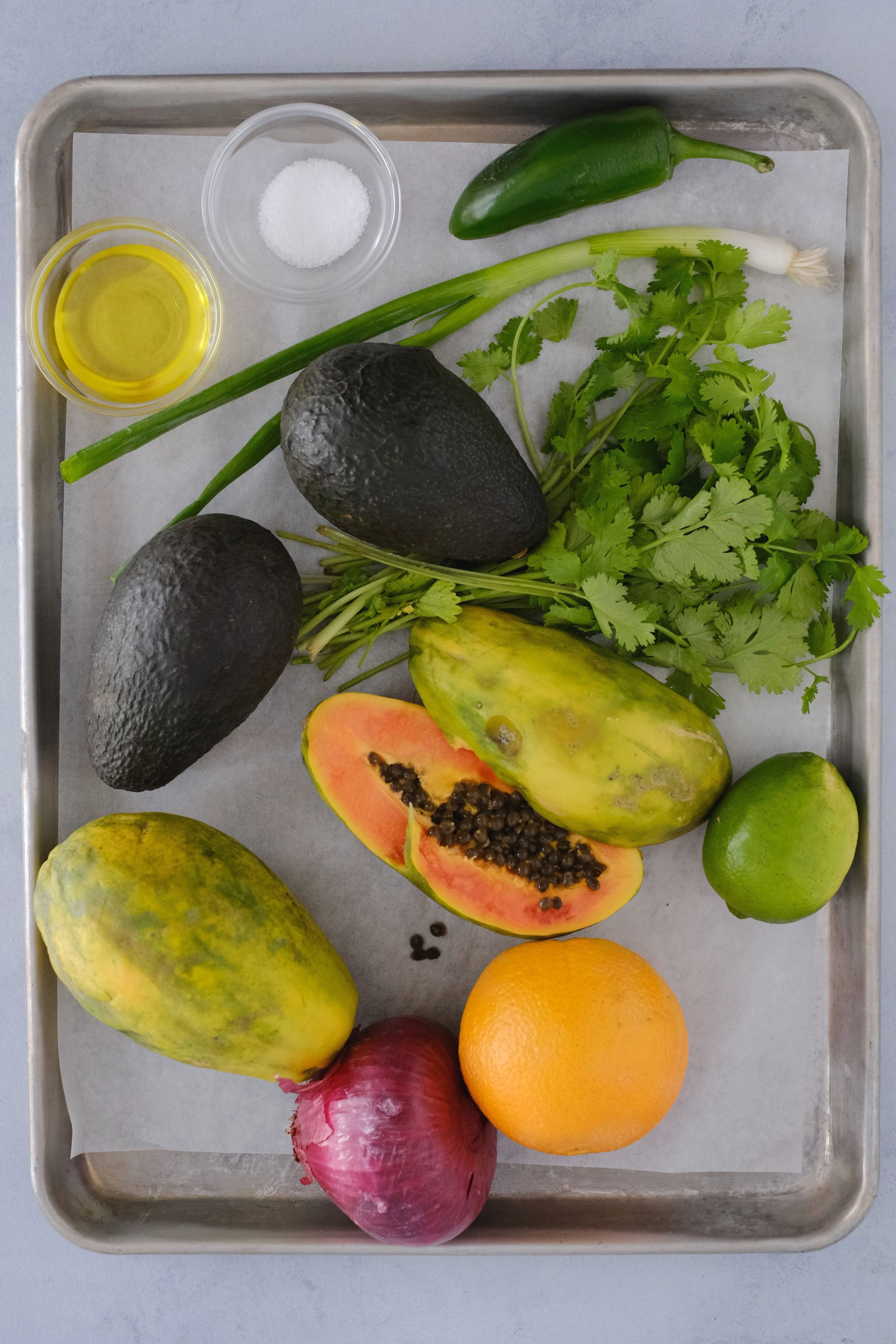 papaya avocado cilantro ingredients on a backing sheet