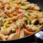 shrimp fajitas in a black skillet
