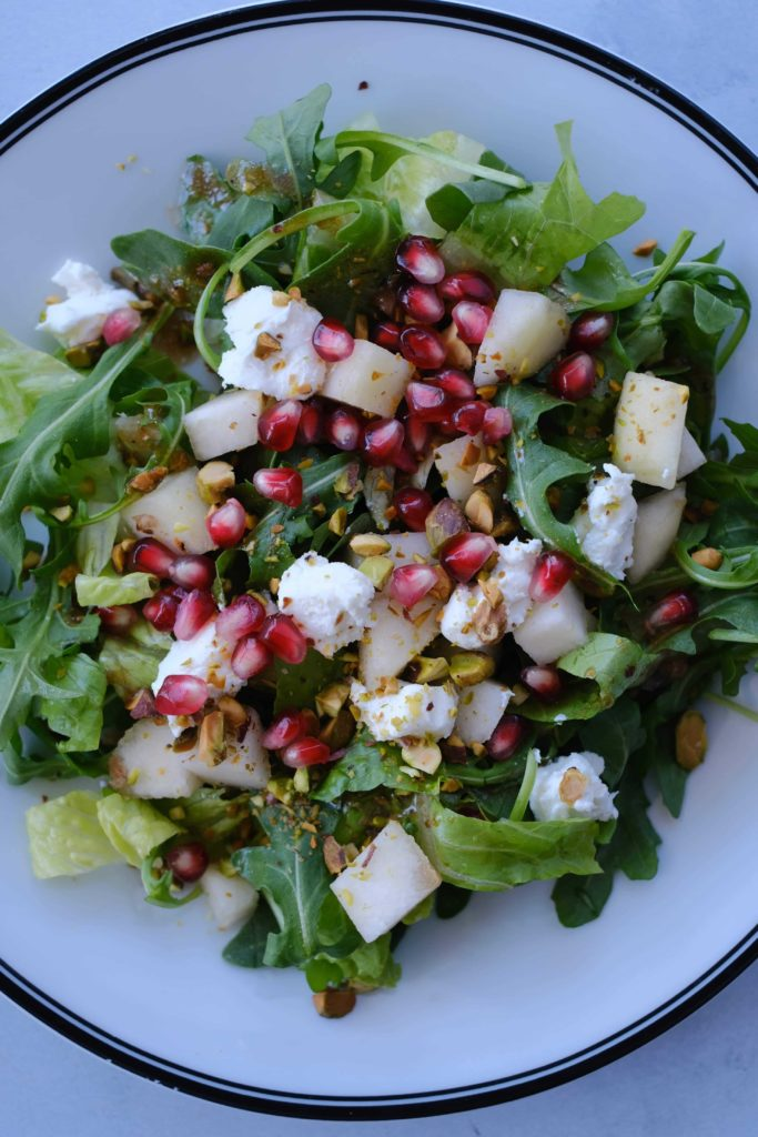 arugula salad on white plate