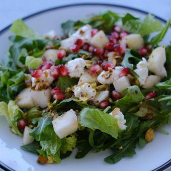 arugula salad on white plate