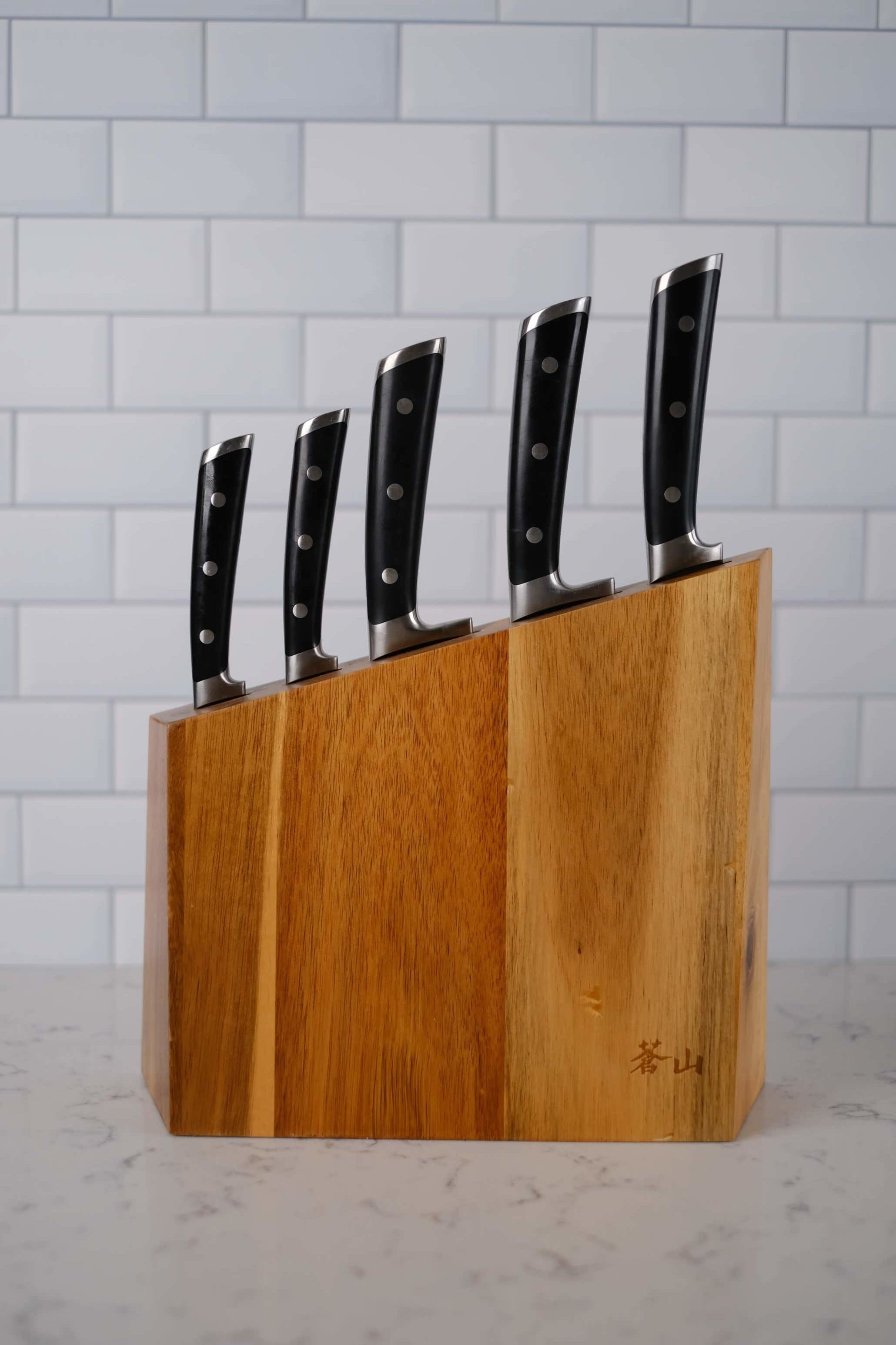 knife block set with five knives on a white countertop
