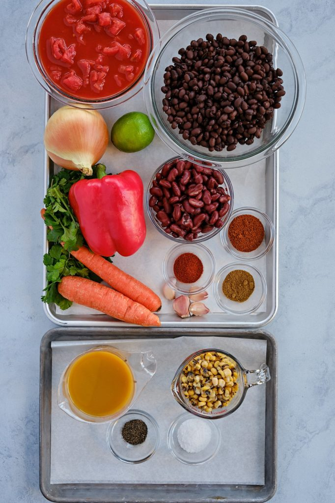 Ingredients for chili on a baking sheet