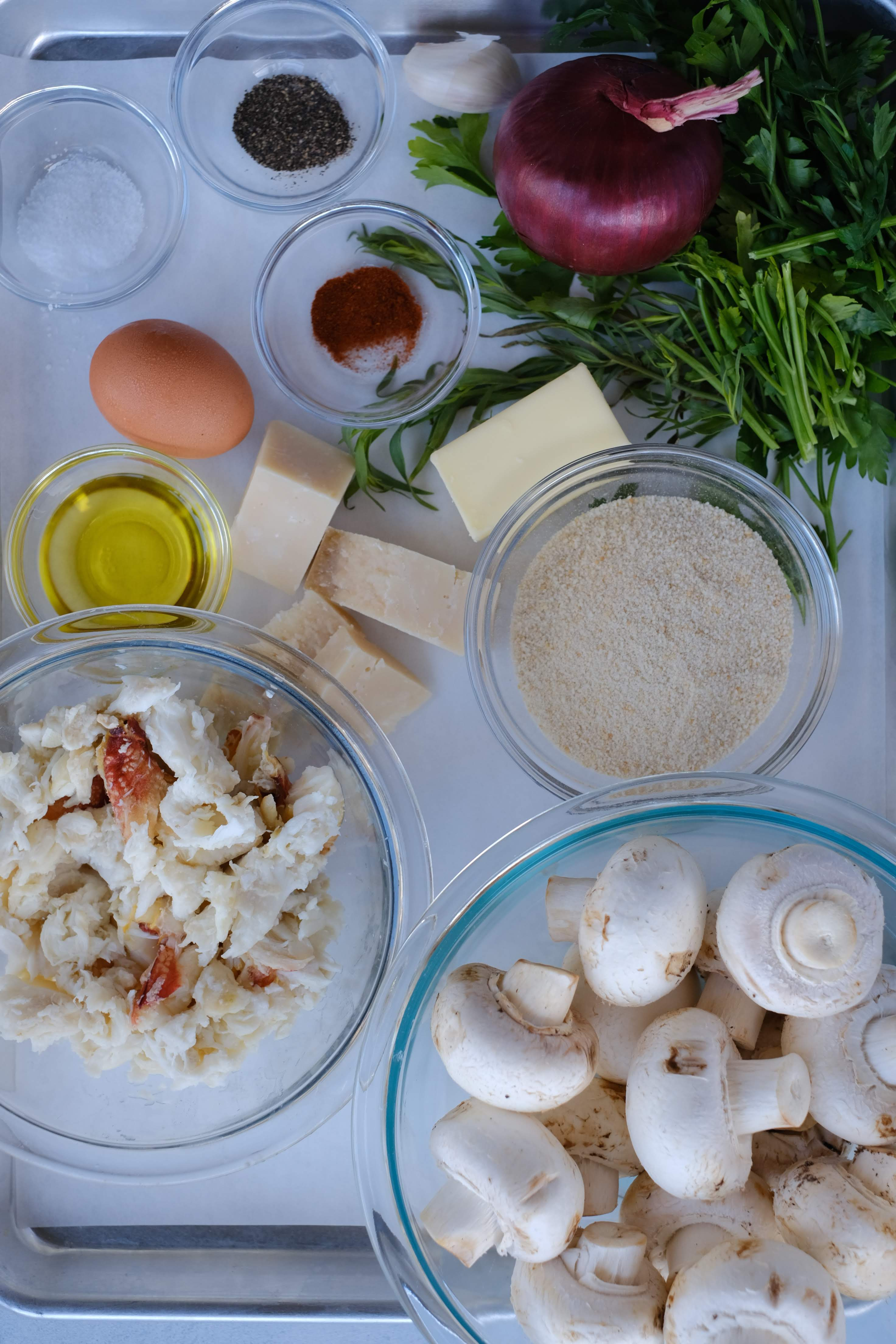 ingredients for crab stuffed mushrooms on a tray