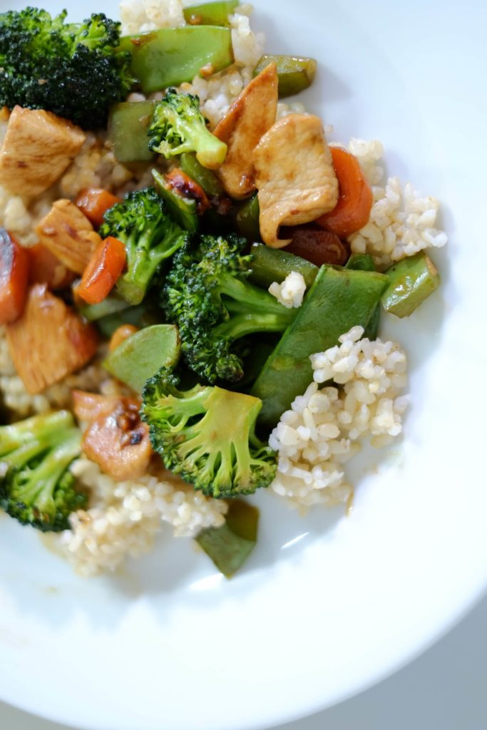 Chicken and Vegetable with brown rice on a white plate
